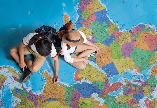 Two Travelers on Giant World Map